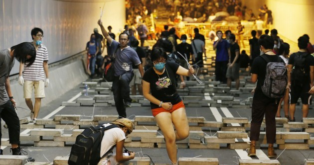 IN PICTURES: Hong Kong protesters battle police to build bamboo barricades