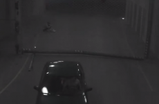 Angry driver tries to fight car park barrier, loses