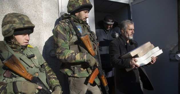 Ukrainian voters head to the polls in snap elections for a new parliament