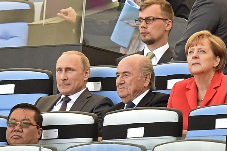 Vladimir Putin, Sepp Blatter and Angela Merkel at the 2014 World Cup opening ceremony.