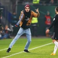 Scarf-wielding supporter run across pitch and slaps Bayern Munich's Franck Ribery