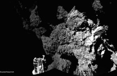 Philae seems to be stuck under a cliff with one leg dangling in space