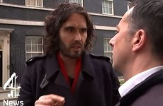 """Russell Brand calls reporter """"a snide"""" after he is asked how much his home is worth"""