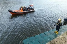 Four men on detached pontoon rescued from river