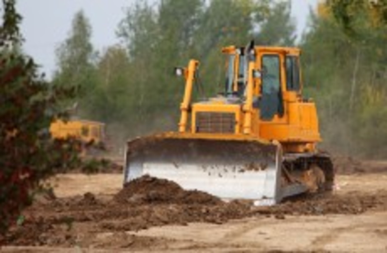 Man On Bulldozer : Man arrested after bulldozer and cash found in search