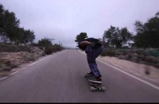 Longboarder has unbelievable near miss with bus