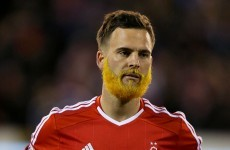 A Nottingham Forest player is rocking the Abel Xavier look to raise money for cystic fibrosis