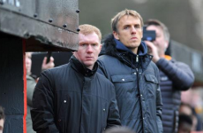 When duty calls: Scholes and Neville took temporary charge of Salford this afternoon