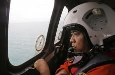 Search area expanded as divers continue recovery of AirAsia victims