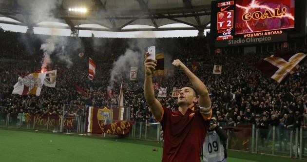 Totti bags two goals in the Rome derby and takes a selfie with the Curva Sud