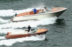 Roger Federer plays Lleyton Hewitt from moving speed boat at Sydney Harbour
