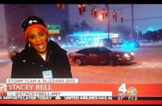 Driver recklessly drifts into news reporter's shot during New York blizzard