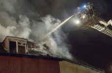 Bus driver helps naked man leap to safety from burning building