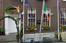 Man rushed to hospital after falling over railings outside Diceys Bar