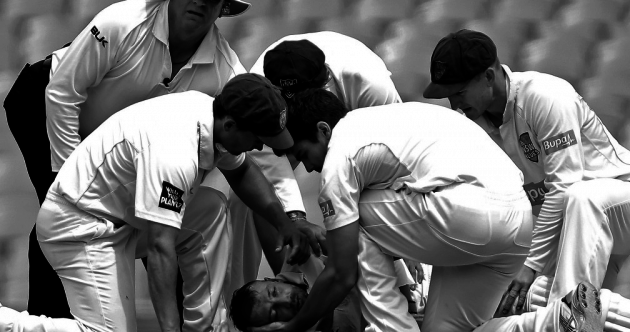 Heartbreaking: Image of injured Phillip Hughes wins prestigious prize