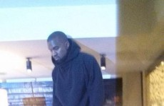 This photo of Kanye West standing on a counter in Nando's is going viral