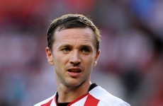 A former Irish international and footballing cult hero has announced his retirement