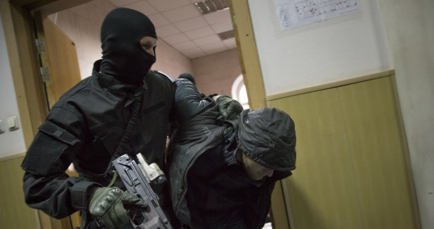 Pictures: Armed and masked police haul Nemtsov suspects before Moscow court