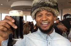 Usher is in Dublin, and sporting an excellent Guinness moustache