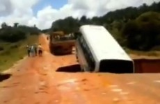 VIDEO: Bus swallowed by massive sinkhole, carried away on flooded river