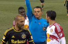 Has a referee ever looked more satisfied to be sending off a player?