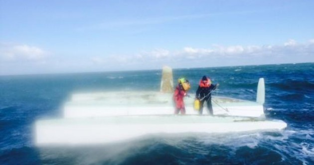Pregnant woman airlifted to hospital after being spotted standing on upturned boat