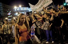 Thousands march in Madrid against Pope's visit