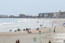 A suspect in a US college shooting has been found – asleep, at the beach