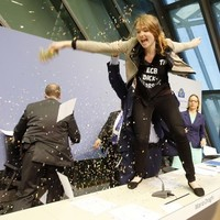 Glitterbombing woman calls for 'end to ECB dictatorship'