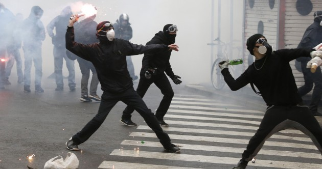 Police use tear gas on stone-throwing protesters