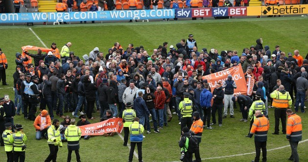 Blackpool's final game of abysmal season abandoned after fans invade pitch in protest