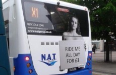"Bus company drops ad campaign that had topless woman with ""Ride me all day"" sign"