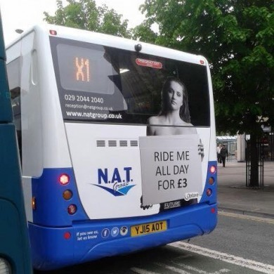 """Bus company drops ad campaign that had topless woman with """"Ride me all day"""" sign"""