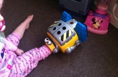Five firefighters had to rescue a little girl who got her foot stuck in a toy robot