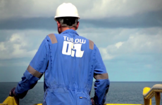 An Irish oil company has agreed to a €220 million tax bill to Uganda