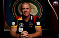 A top Aussie Rules head coach was stabbed to death and his son's been charged with murder