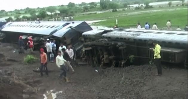 Photos show extent of devastating train derailment that killed dozens