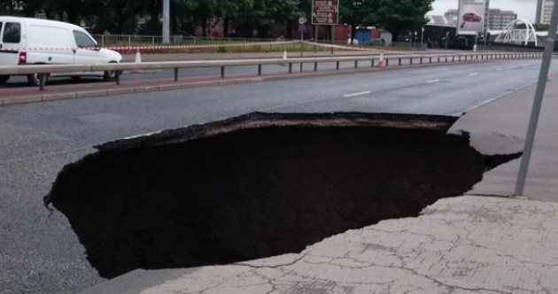 Yikes! This enormous hole opened up in a road in Manchester today