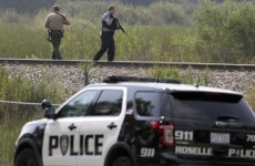 Police hunt for three suspects after officer is shot dead
