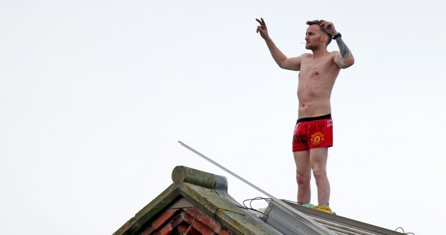 Crowd holds street party for inmate who's been on prison roof for three days