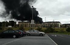 Huge plumes of smoke billow from Dublin building as crews battle fire