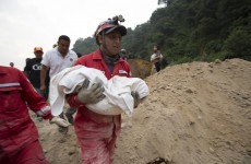 Families receive text messages from trapped relatives after 30 people killed by landslide
