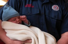 Baby boy visits firefighters who helped deliver him last week