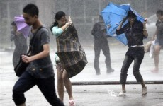 Asia reels from floods as storm hits Vietnam