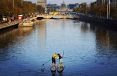 Here's the story behind this gorgeous photo of a couple kissing in the Liffey