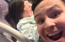 A new dad posed for a selfie with his wife giving birth in the background