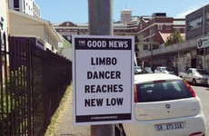 This guy puts a positive spin on headlines and sticks them up around his town