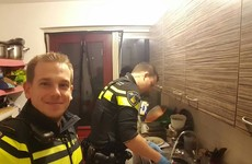 A photo of two dotey policemen washing dishes is going viral for a very good reason