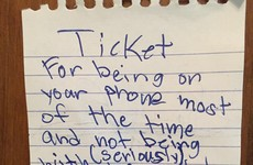 This little kid just wrote his Mam a 'ticket' for being on her phone too much