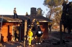 Suspected burglar killed after fire lit in chimney he was stuck in
